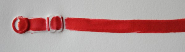 Bra Strap, 1997, my bra (originally white, but inked red) relief printed & embossed on Rives BFK