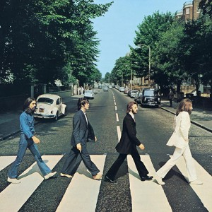 The Beatles walking across Abbey Road