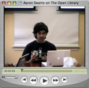 Top 5 Podcasts 2014: #3 MediaBerkman from The Berkman Center for Internet and Society at Harvard University. Image of a video player with a video of Aaron Swartz speaking on The Open Library