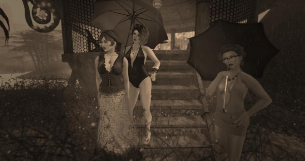 sepia toned photo of RMarie Beedit, Vanessa Blaylock and Soto Hax standing in the rain in a jungle brush area