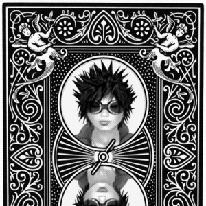 """back of a custom playing card featuring the traditional """"bicycle"""" type ornamented design,  but with Moto (Moderato Ware) inserted in the center circles"""