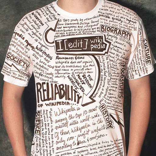 "person in a ""Wikipedia"" t-shirt featuring writing and diagrams about structuring the encyclopedia"