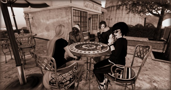 4 avatars sit at a terrace table outside Bacon Barista