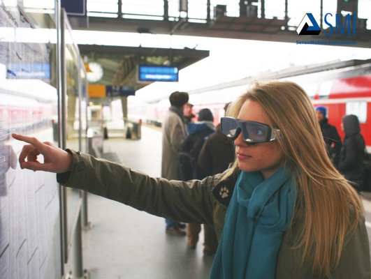 University Guiding Principles: photo of a woman wearing SMI Eye Tracking glasses and working with a wall-mounted subway map
