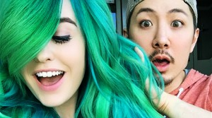 Closeup of Guy Tang and Super Mary Face. Tang with an astonished expression on his face, and Mary Face smiling.