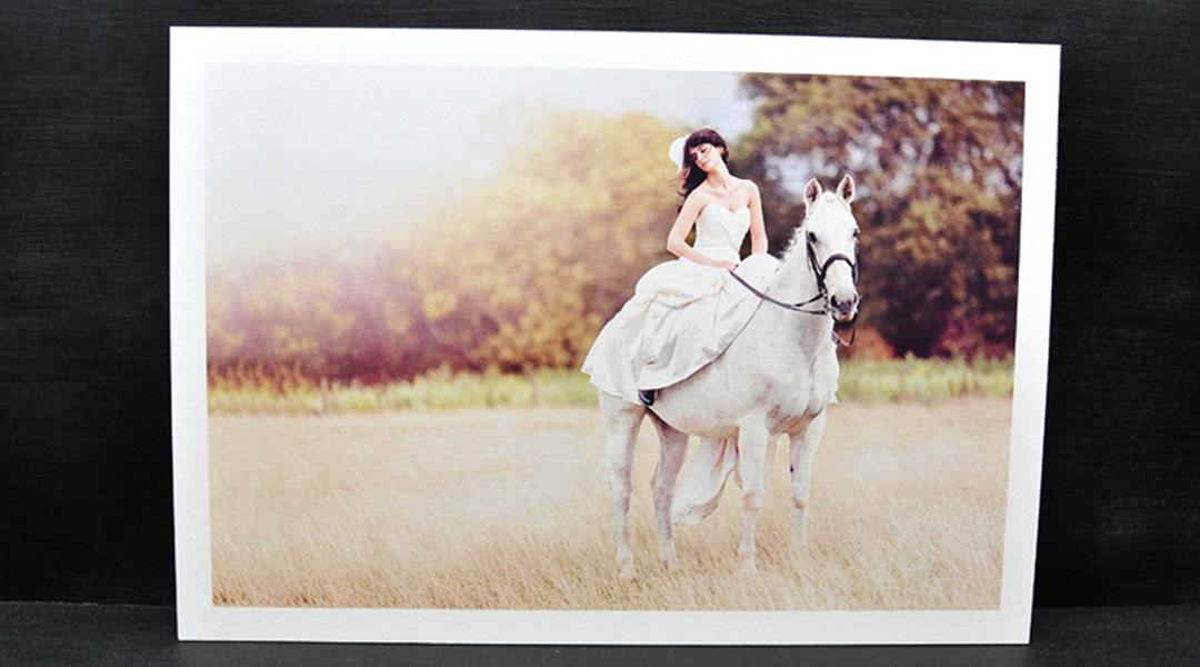 Fine art print of a woman in a white dress riding a white horse