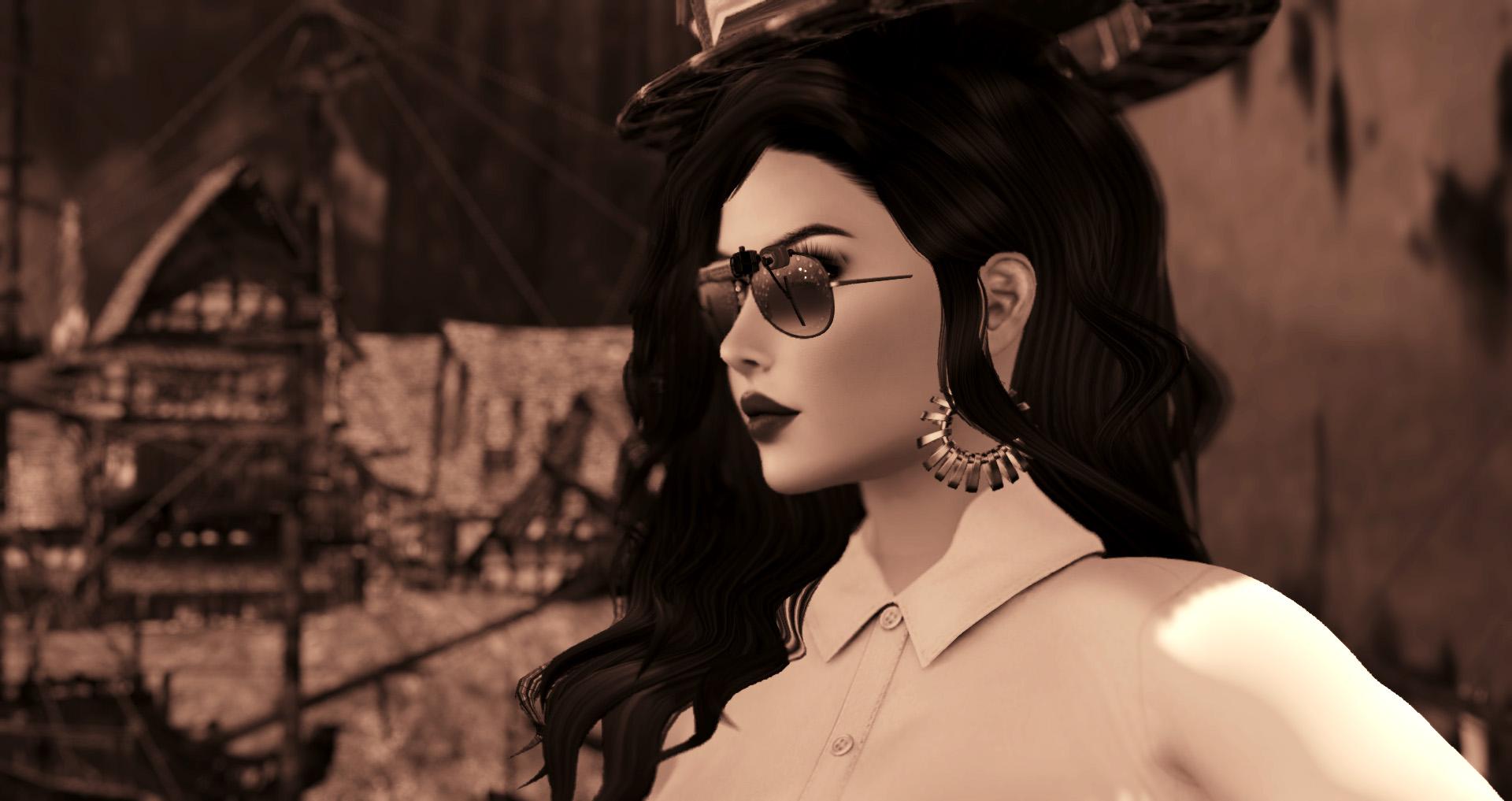 selenium toned headshot of Agnes Sharple wearing sunglasses and a white shirt