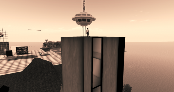 Standing on top of Olive's Apartment Tower with Chris Craft's Space Needle in the distance behind me.