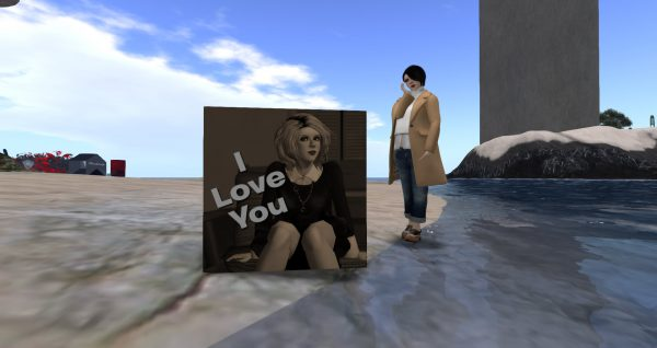 """Vanessa Blaylock standing next to a cube bearing her photo and the words """"I Love You"""""""