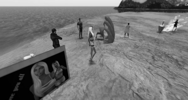 black and white photo of avatars working on the beach at Love Beach at LEA1 in Second Life